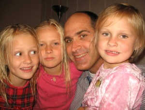 Author Hoyt Smith with his three beautiful girls, long before he had thoughts of spring break.