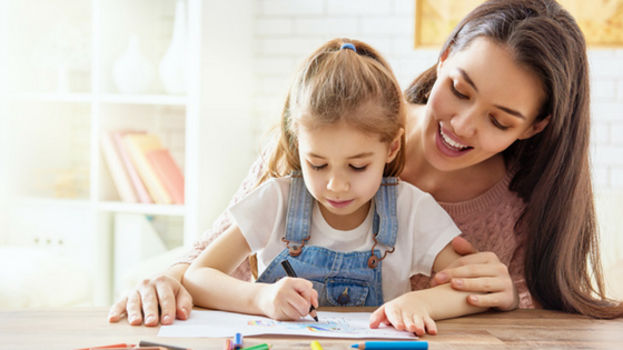 little-girl-coloring-in-with-her-mom